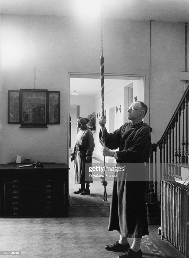 During The 1950'S, A Monk Rings The Bell At The St Michael Abbey.Napoleon Iii Tomb Is On The Abbey Crypt.