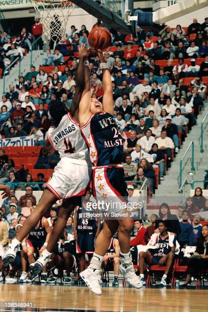 During the American Basketball League AllStar game American basketball player Natalie Williams of the Western Conference rebounds over Teresa Edwards...