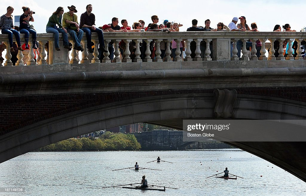 During the annual Head of the Charles Regatta, spectators line the Weeks Footbridge to watch the club women's singles.