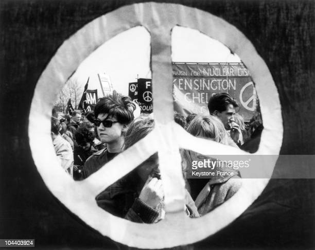 During the antinuclear demonstration from Aldermaston to London this PEACE AND LOVE symbol frames the marchers and their banners The annual march...