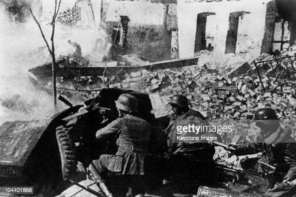 During the Battle of Stalingrad German soldiers use an antitank cannon in a street of the city