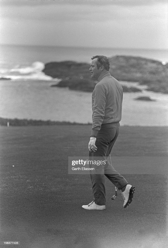 During the Bing Crosby National ProAmateur golf tournament American actor Jack Lemmon walks on the course near the 16th hole at Cypress Point Pebble...