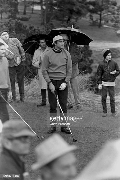 During the Bing Crosby National ProAmateur golf tournament Scottish actor Sean Connery reacts to his tee shot on the course at Cypress Point Pebble...
