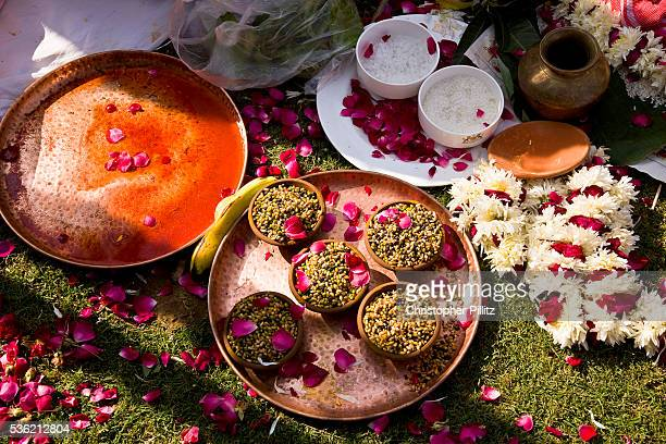 During the course of a Hindu wedding ceremony flower petals and other offerings such as Turmeric sandlewood salt rice bananas and many other...