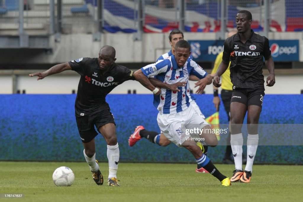 during the Dutch Eredivisie match between sc Heerenveen and Heracles Almelo on August 18, 2013 at the Abe Lenstra stadium in Heerenveen, The Netherlands. (L-R), Matthew Amoah of Heracles Almelo, Rajiv van La Parra of SC Heerenveen, during the Dutch Eredivisie match between sc Heerenveen and Heracles Almelo on August 18, 2013 at the Abe Lenstra stadium in Heerenveen, The Netherlands.