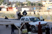 During the Eid alFitr Islamic State of Iraq and Levantled militants patrol on the roads of Baiji after they control the city in Iraq on July 30 2014