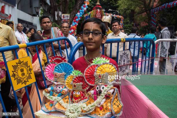 During the festival of rathyatra a boy is selling the idols of lord jagannath bararam and subhadra to the devotees in Kolkata India on 2562017Rath...