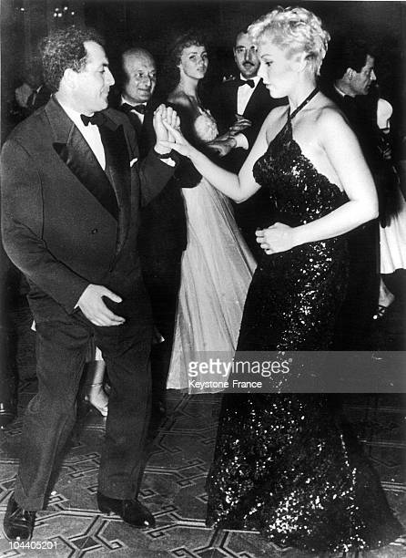 During the inaugural party of Cannes film festival the American actress Kim NOVAK the muse of HITCHCOCK danced with a reporterphotographer