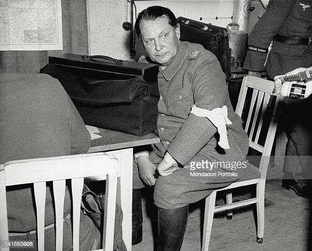 During the interrogation after the capture marshal Hermann Goering's uniform is deprived of medals and decorations on the right one of the personal...