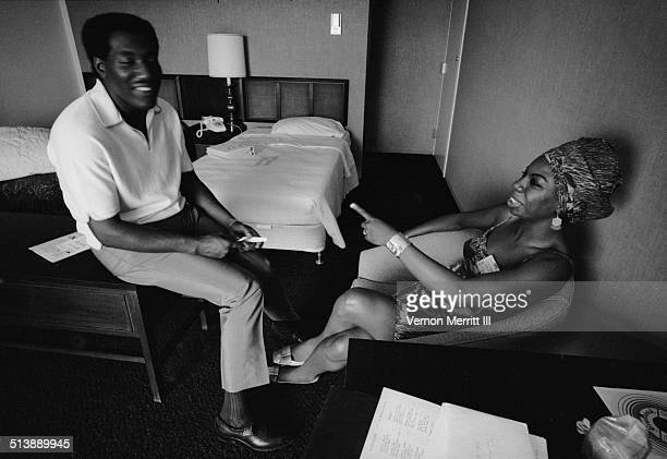 During the NARA convention musicians Otis Redding and Nina Simone share a laugh in a room at the Regency Hyatt Hotel Atlanta Georgia August 9 through...