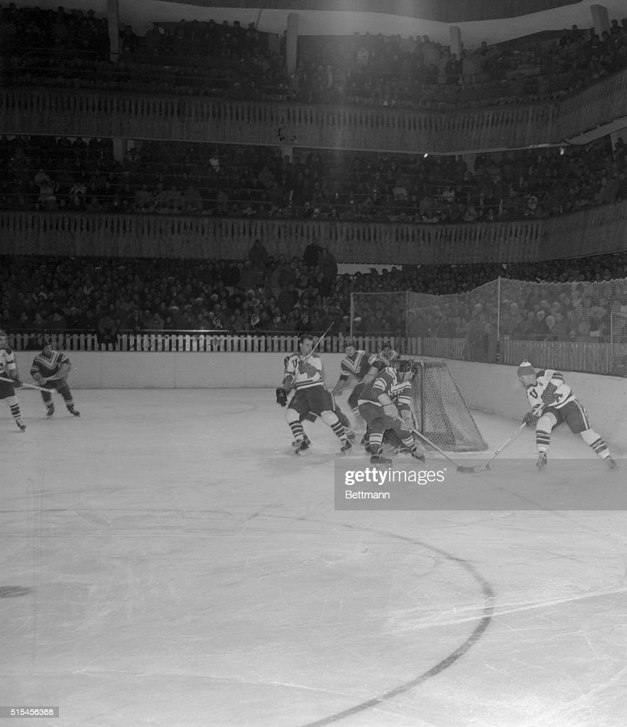 During the Olympic hockey tournament in the Winter Games at Cortina February 3 Russian goalie Nikolai Puchkov and a Soviet defenseman block a scoring...