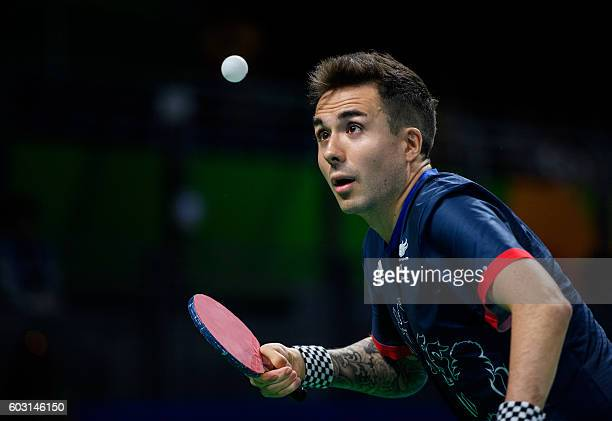 Great Britain's William John Bayley plays against Brazil's Israel Pereira Stroh in their Men's Singles Class 7 Gold Medal table tennis match at the...