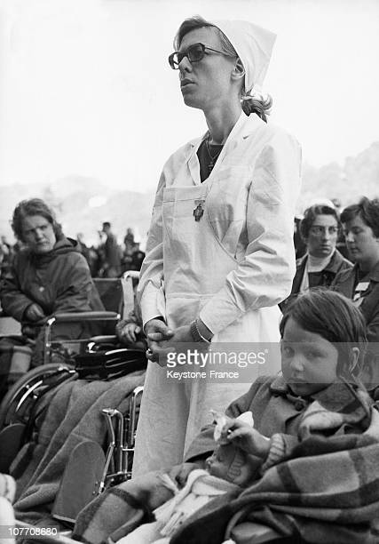 During The Pilgrimage Of Patients With Polio A Child And His Nurse At The Mass Celebrated Before The Cave On September 26Th 1968