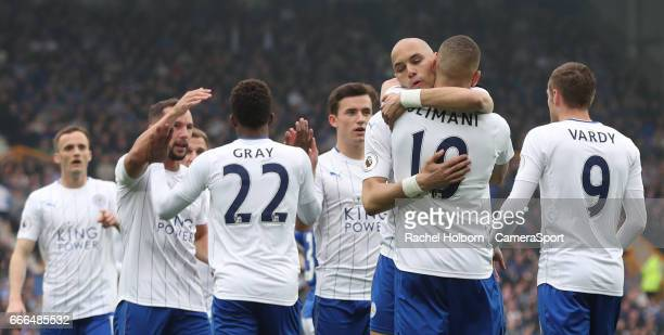 Leicester City's Islam Slimani celebrates scoring his sides first goal LIVERPOOL ENGLAND APRIL 09 during the Premier League match between Everton and...