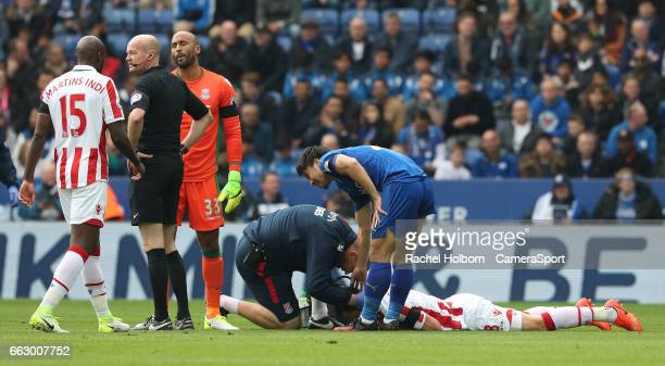 Stoke City's Saido Berahino lies injured on the floor LEICESTER ENGLAND APRIL 01 during the Premier League match between Leicester City and Stoke...
