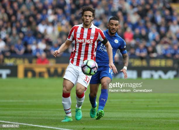 Stoke City's Ramadan Sobhi and Leicester City's Danny Simpson LEICESTER ENGLAND APRIL 01 during the Premier League match between Leicester City and...