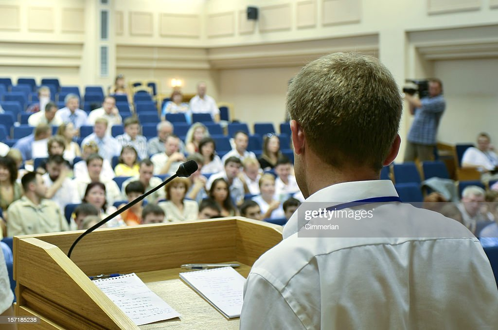 During the presentation the make speaker addressed a forum : Stock Photo