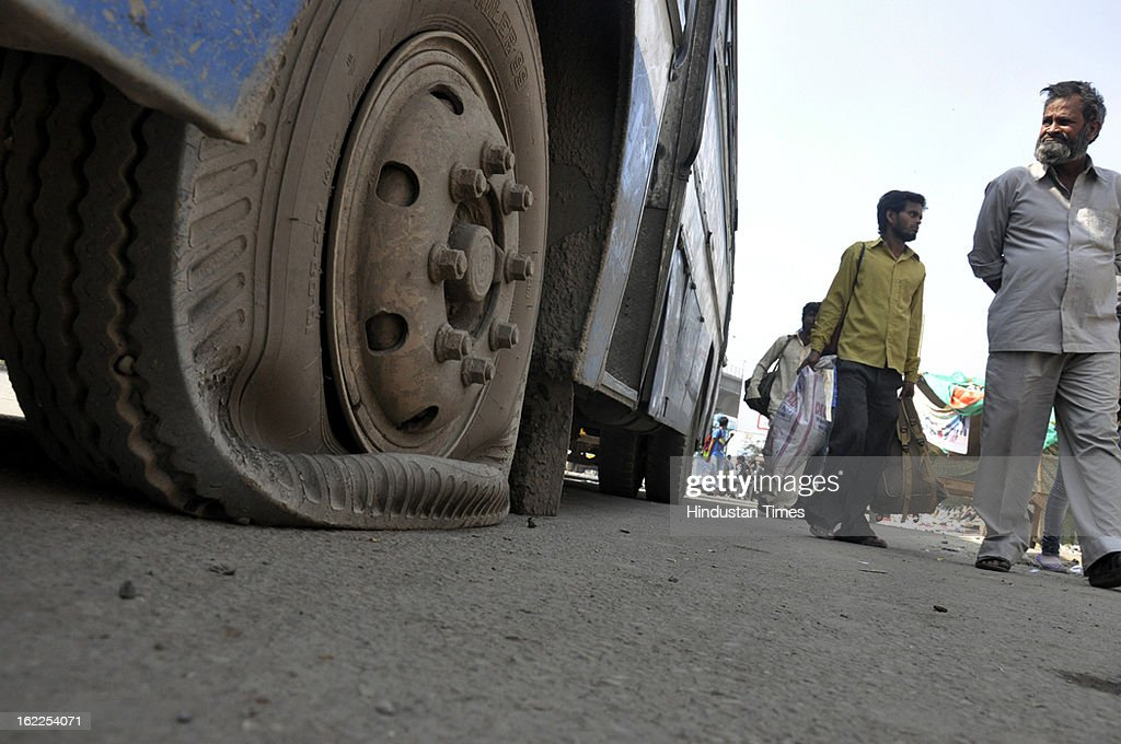 During the second day of Bandh (Strike) protesters deflated tyres of UPSRTC buses near Kaushambi on February 21, 2013 in Ghaziabad, India. Two-day nationwide strike called by various trade unions to protest against Government's economics and labor policies.