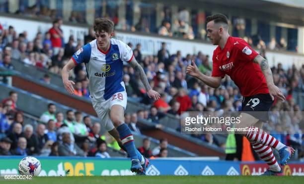 Blackburn Rovers' Connor Mahoney and Barnsley's Gethin Jones BLACKBURN ENGLAND APRIL 08 during the Sky Bet Championship match between Blackburn...