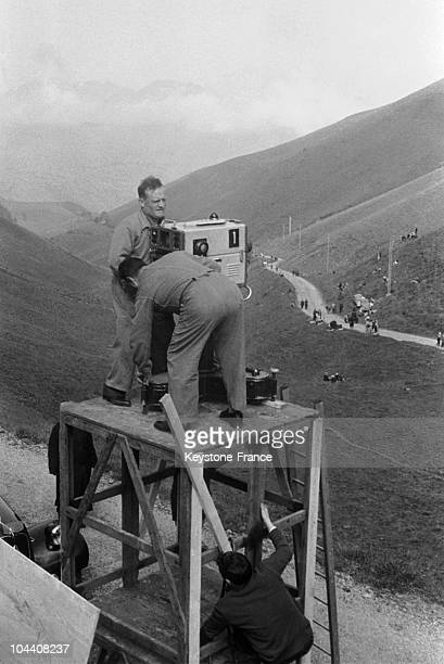 During the Tour de France men are setting up a camera in order to retransmit the race on television