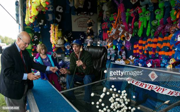 During the Turner Community Day festival at Steineger Field American politician US Senator Pat Roberts pays to plays a carnival game Kansas City...
