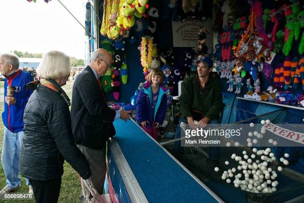 During the Turner Community Day festival at Steineger Field American politician US Senator Pat Roberts wins a small blue elephant at a carnival game...