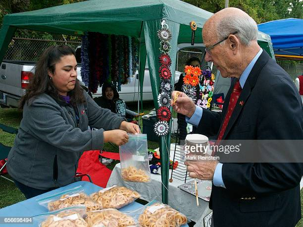 During the Turner Community Day festival at Steineger Field American politician US Senator Pat Roberts samples homemade food at a stall Kansas City...