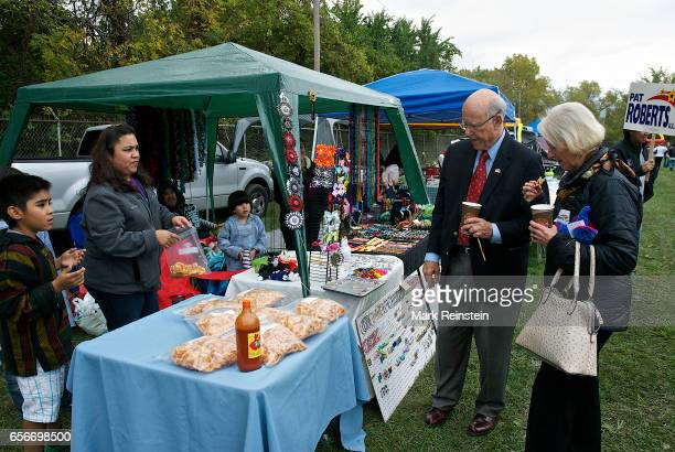 During the Turner Community Day festival at Steineger Field American politician US Senator Pat Roberts and his wife Franki Roberts sample homemade...