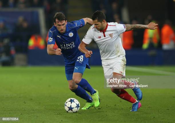 Leicester City's Christian Fuchs and Sevilla's Vitolo LEICESTER ENGLAND MARCH 14 during the UEFA Champions League Round of 16 second leg match...