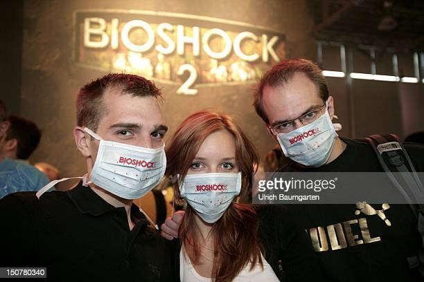 GERMANY COLOGNE During the visit of the 2KGames stand of Gamescom mouth protection as a precaution against the pig flu on the Gamescom in Cologne
