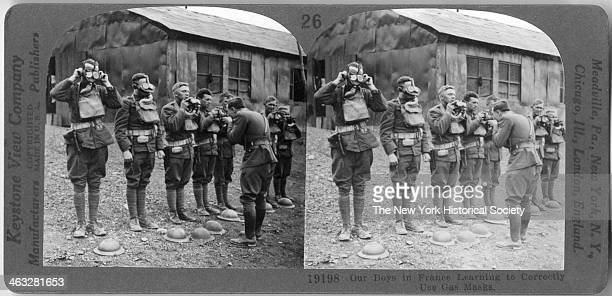 During World War I American soldiers are instructed in the proper use of gas masks in France