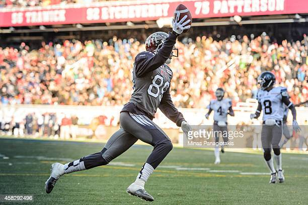 Duron Carter of the Montreal Alouettes celebrates his touchdown during the second half of the CFL game against the Toronto Argonauts at Percival...