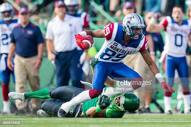 Duron Carter of the Montreal Alouettes fights for extra yards in a game between the Montreal Alouettes and Saskatchewan Roughriders in week 8 of the...