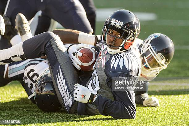 Duron Carter of the Montreal Alouettes looks on after being tackled during the CFL game against the Toronto Argonauts at Percival Molson Stadium on...