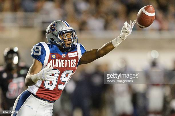 Duron Carter of the Montreal Alouettes misses a pass against the Ottawa Redblacks during the CFL game at Percival Molson Stadium on August 29 2014 in...