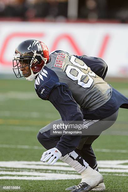 Duron Carter of the Montreal Alouettes protects the ball during the CFL game against the Toronto Argonauts at Percival Molson Stadium on November 2...
