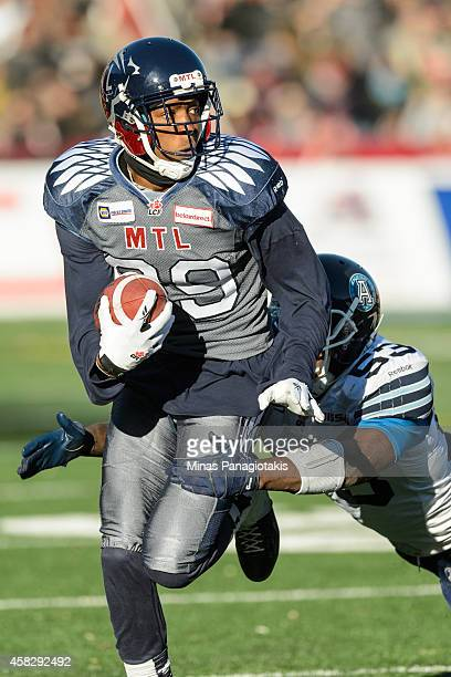 Duron Carter of the Montreal Alouettes runs past Gregory Jones of the Toronto Argonauts during the CFL game at Percival Molson Stadium on November 2...