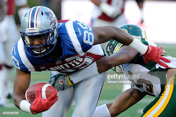 Duron Carter of the Montreal Alouettes runs with the ball after a missed tackle by Dexter McCoil of the Edmonton Eskimos during the CFL game at...