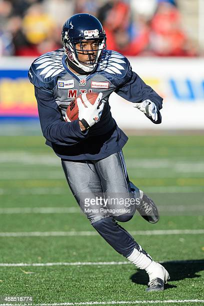Duron Carter of the Montreal Alouettes runs with the ball during the CFL game against the Toronto Argonauts at Percival Molson Stadium on November 2...