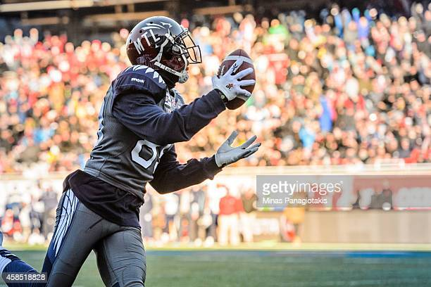 Duron Carter of the Montreal Alouettes scores a touchdown during the CFL game against the Toronto Argonauts at Percival Molson Stadium on November 2...