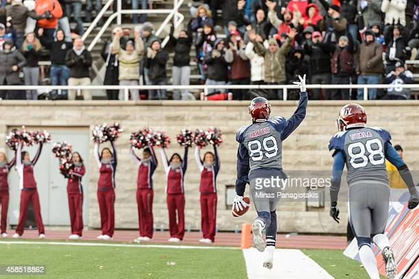 Duron Carter of the Montreal Alouettes turns to the fans to celebrate his touchdown during the CFL game against the Toronto Argonauts at Percival...