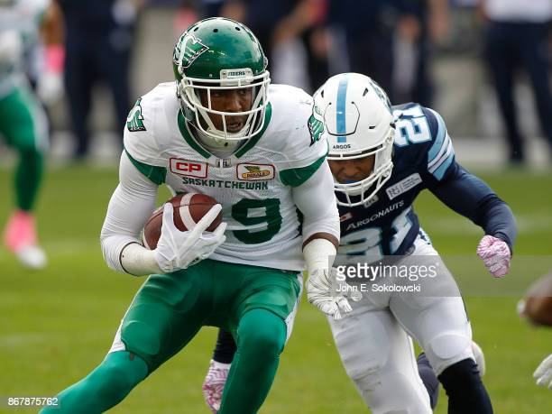 Duron Carter of the Saskatchewan Roughriders gains yards after a catch as Qudarius Ford of the Toronto Argonauts closes in during a game at BMO field...