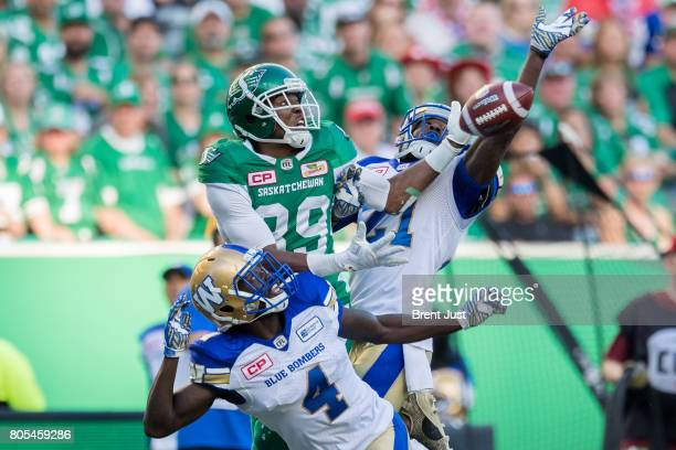 Duron Carter of the Saskatchewan Roughriders hauls in a deep pass in between the coverage of Roc Carmichael and Brandon Alexander of the Winnipeg...