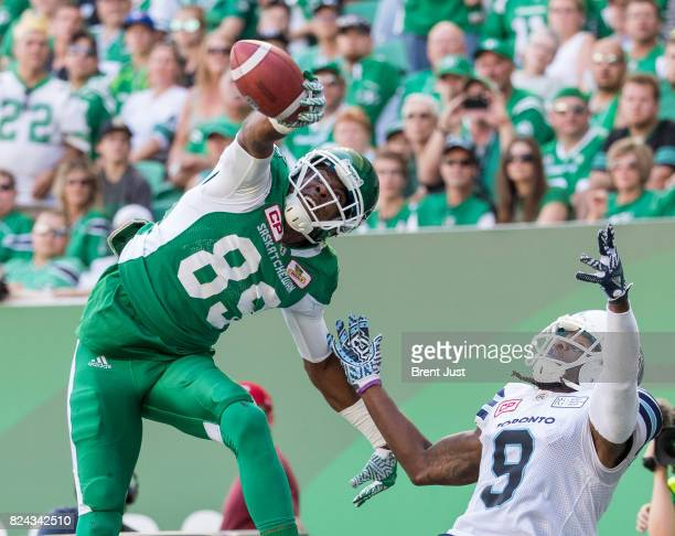 Duron Carter of the Saskatchewan Roughriders makes a great one handed catch over Akwasi OwusuAnsah of the Toronto Argonauts for a late first half...