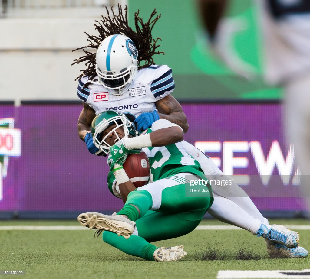 Duron Carter #89 of the Saskatchewan Roughriders makes a touchdown catch in front of Johnny Sears Jr. #0 of the Toronto Argonauts in the second half of the game between the Toronto Argonauts and Saskatchewan Roughriders at Mosaic Stadium on July 29, 2017 in Regina, Canada.