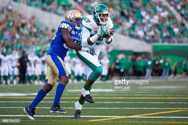 Duron Carter of the Saskatchewan Roughriders makes the first touchdown catch in the new Mosaic Stadium in the preseason game between the Winnipeg...