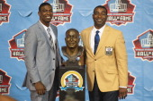 Duron Carter presents his father and former receiver Cris Carter of the Minnesota Vikings with his Hall of Fame bust during the NFL Class of 2013...