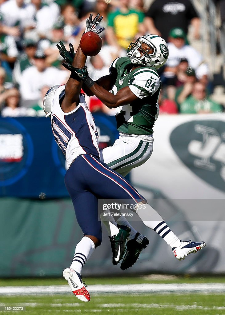 Duron Harmon of the New England Patriots breaks up a pass intended for Stephen Hill of the New York Jets during their game at MetLife Stadium on...