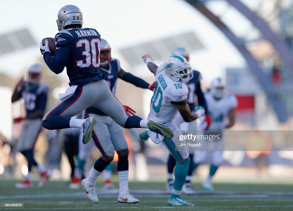 <a gi-track='captionPersonalityLinkClicked' href=/galleries/search?phrase=Duron+Harmon&family=editorial&specificpeople=8142142 ng-click='$event.stopPropagation()'>Duron Harmon</a> #30 of the New England Patriots intercepts a pass during the second quarter against the Miami Dolphins at Gillette Stadium on December 14, 2014 in Foxboro, Massachusetts.