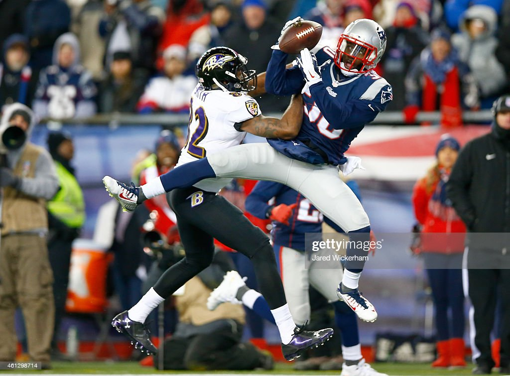 Duron Harmon of the New England Patriots intercepts a pass late in the game during the 2015 AFC Divisional Playoffs game against the Baltimore Ravens...